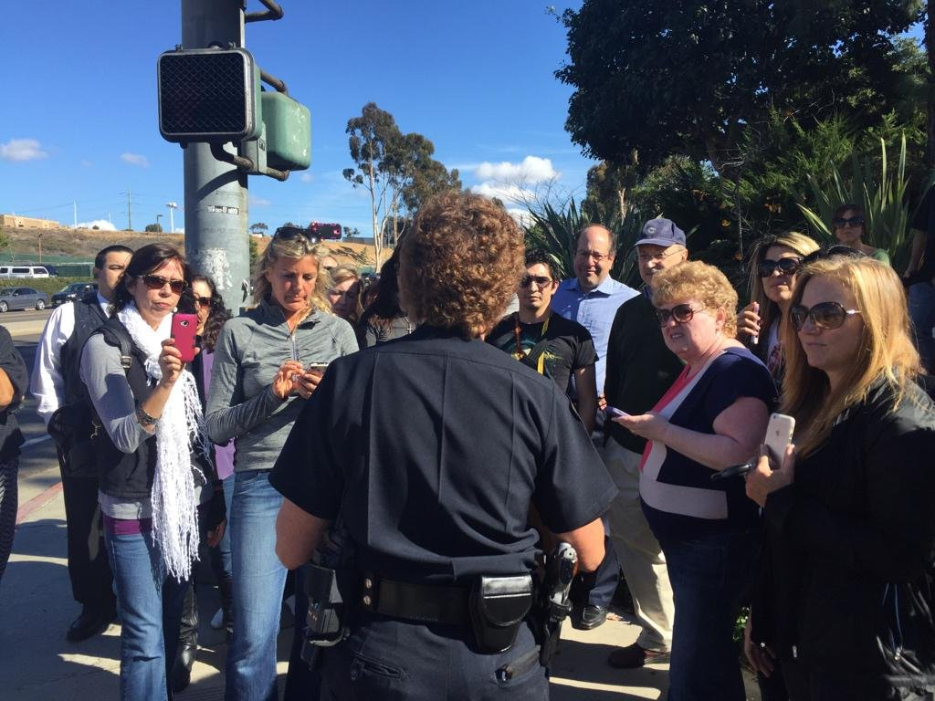SDPD briefing concerned parents outside Torrey Pines High School, Thursday, November 20, 2014. Photo courtesy: @MattCBS8