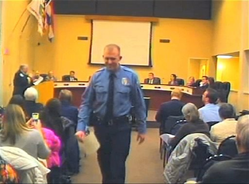 FILE - In this Feb. 11, 2014 file image from video provided by the City of Ferguson, Mo., officer Darren Wilson attends a city council meeting in Ferguson.