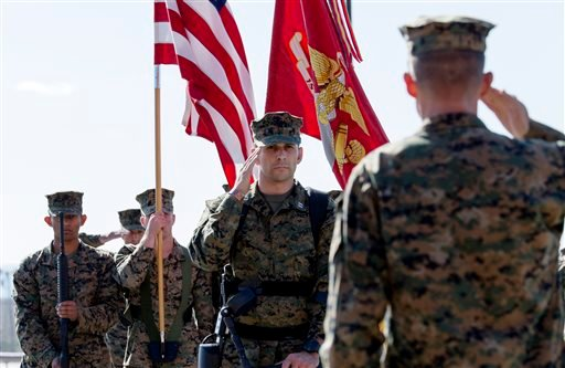 In this photo provided by the U.S. Marines, U.S. Marine Capt. Derek Herrera, center, 1st Marine Special Operations Battalion, salutes during his awards and retirement ceremony at Camp Pendleton, Calif., on Friday, Nov. 21, 2014. (AP)