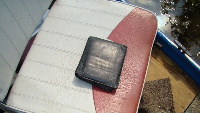 Tatro's wallet found on the boat's fishing seat
