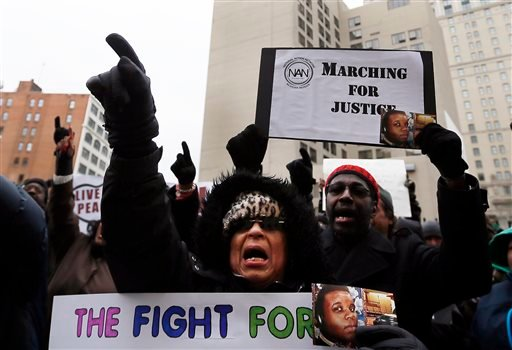 Renla Session chants during a protest in Detroit Tuesday, Nov. 25, 2014 in response to the Ferguson grand jury decision not to indict police officer Darren Wilson in the death of Michael Brown. (AP Photo/Paul Sancya)