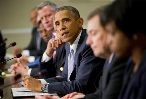 President Barack Obama, center, speaks during his meeting with elected officials, law enforcement officials and community and faith leaders in the Old Executive Office Building on the White House Complex in Washington, Monday, Dec. 1, 2014. (AP)