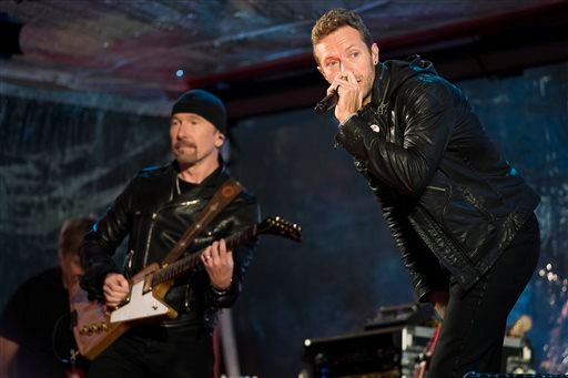 The Edge, left, and Chris Martin perform during the World AIDS Day (RED) concert In Times Square on Monday, Dec. 1, 2014 in New York.