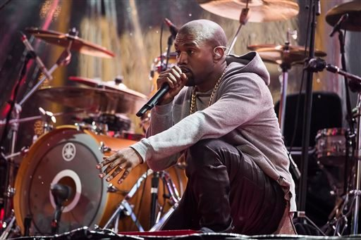 Kanye West performs during the World AIDS Day (RED) concert In Times Square on Monday, Dec. 1, 2014 in New York.