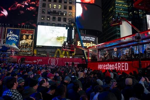 Chris Martin and U2 perform during the World AIDS Day (RED) concert In Times Square on Monday, Dec. 1, 2014 in New York.