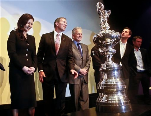 Actors Catherine Zeta-Jones, far left, and Michael Douglas, third from left, join Bermuda's Premier Michael Dunkley, second from left, for a photo with the America's Cup trophy, Tuesday Dec. 2, 2014. in New York.