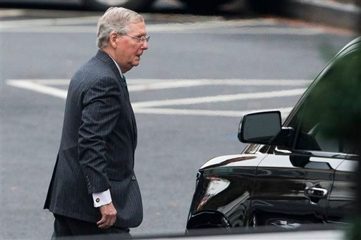 Senate Minority Leader Sen. Mitch McConnell of Ky. leaves the White House in Washington, Wednesday, Dec. 3, 2014, after a meeting with President Barack Obama. (AP)