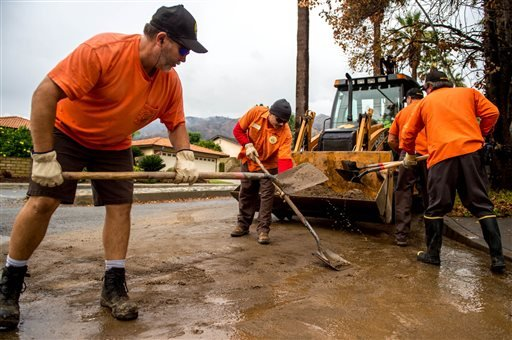 Glendora work crews clear mud and debris along Kregmont Drive in Glendora on Wednesday, Dec. 3, 2014. More rain is expected in the Southland today, with potential mudslides in area previously denuded by the Colby Fire.