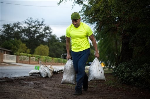 Preparing for the next round of storm, resident Edward Bikle, 46, helps put sandbags in front of an elderly resident's home in 100 block of W. Sierra Madre Avenue in Glendora on Wednesday, Dec. 3, 2014.