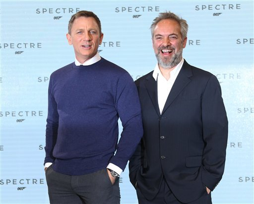 Actor Daniel Craig and Director Sam Mendes pose for photographers pose for photographers at the announcement for the new Bond film, the 24th in the series, at Pinewood Studios in west London, Thursday, Dec. 4, 2014.