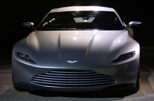 The Aston Martin DB10 is revealed at the announcement for the new Bond film, the 24th in the series, at Pinewood Studios in west London, Thursday, Dec. 4, 2014.