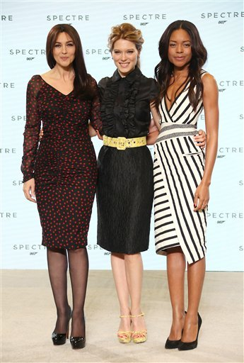 From left, actresses Monica Bellucci, Lea Seydoux and Naomie Harris pose for photographers at the announcement for the new Bond film, the 24th in the series, at Pinewood Studios in west London, Thursday, Dec. 4, 2014.