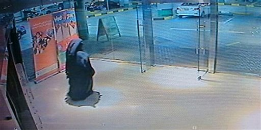 This image made from video released by the Abu Dhabi police department on Tuesday, Dec. 2, 2014 shows a veiled suspect in the stabbing of an American teacher in a shopping mall restroom as seen on security camera footage in Abu Dhabi.