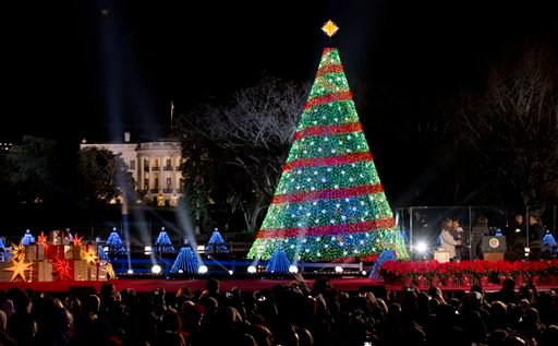 President Barack Obama and the first family stands, right, after lighting the 2014 National Christmas Tree during the National Christmas Tree lighting ceremony at the Ellipse near the White House in Washington, Thursday, Dec. 4, 2014. (AP Photo)