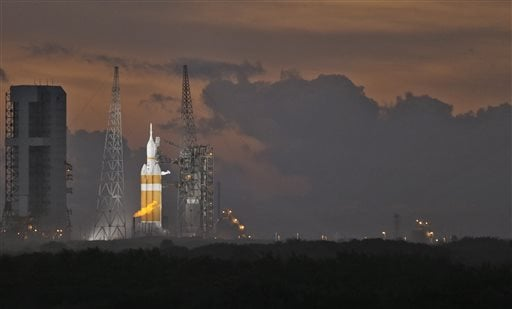NASA's Orion spacecraft, atop a United Launch Alliance Delta 4-Heavy rocket, sits on the launch pad before its first scheduled unmanned orbital test flight from the Cape Canaveral Air Force Station, Thursday, Dec. 4, 2014, in Cape Canaveral, Fla. (AP)