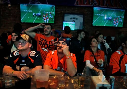 FILE - In this Feb. 2, 2014 file photo, Denver Broncos fans watch their team play the Seahawks during the first half of the Super Bowl, inside Jackson's, a sports bar and grill in Denver. (AP)