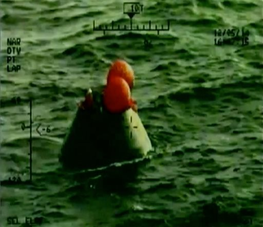 In this frame grab from NASA-TV, the Orion capsule floats after splashing down in the Pacific Ocean, Friday, Dec. 5, 2014.