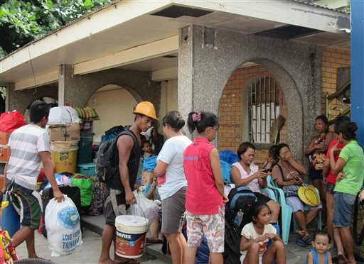 Residents arrive at an evacuation center in Tacloban city, Leyte province, central Philippines Thursday, Dec. 4, 2014, as they prepare for approaching Typhoon Hagupit.