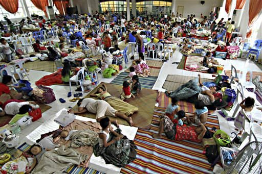 Hundreds of residents take shelter inside the provincial capitol of Surigao city close to central Philippines on Friday, Dec. 5, 2014 in anticipation of typhoon Hagupit which is expected to hit land Saturday afternoon. (AP)