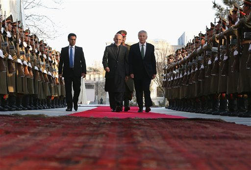 Afghan President Ashraf Ghani walks with U.S. Secretary of Defense Chuck Hagel (R) down a red carpet during an arrival ceremony at the Presidential Palace, Saturday, Dec. 6, 2014 in Kabul, Afghanistan. Defense Secretary Hagel and President Ghani later hel
