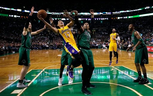 Los Angeles Lakers guard Jeremy Lin (17) shoots after threading through the Boston Celtics during the first half of an NBA basketball game in Boston, Friday, Dec. 5, 2014. (AP Photo/Charles Krupa)