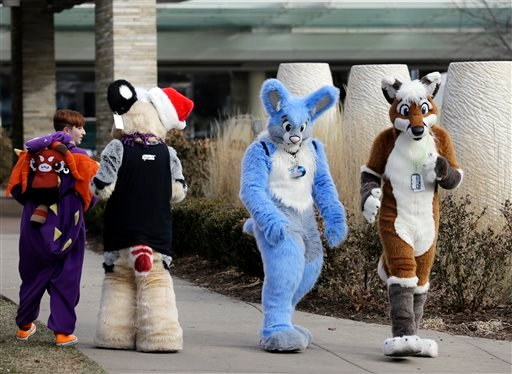 Frederic Cesbron, right and Maxim Durand, walk on the street outside the Hyatt Regency O'Hare hotel on Sunday, Dec. 7, 2014, in Rosemont, Ill. Thousands of people were evacuated after a chlorine gas leak at the hotel hosting the 2014 Midwest FurFest conve