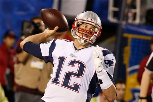 New England Patriots quarterback Tom Brady throws a pass against the San Diego Chargers during the first half in an NFL football game Sunday, Dec. 7, 2014, in San Diego.