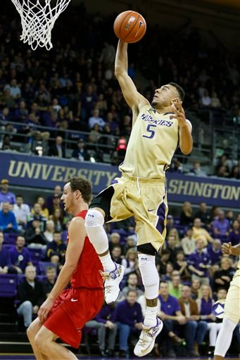 Washington guard Nigel Williams-Goss (5) goes up for a basket against San Diego State forward Matt Shrigley (40) in the first half of an NCAA college basketball game, Sunday, Dec. 7, 2014, in Seattle, Wash.
