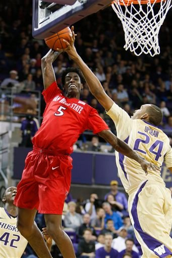 San Diego State forward Dwayne Polee II (5) gets his attempted dunk blocked by Washington center Robert Upshaw (24) in the second half of an NCAA college basketball game.