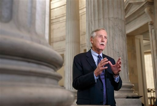 Senate Intelligence Committee member, Sen. Angus King, I-Maine, defends the panel's planned release of a report on the CIA's harsh interrogation techniques, Tuesday, Dec. 9, 2014, during a TV news show interview on Capitol Hill in Washington. (AP Photo/J.