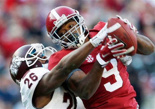 In this Nov. 15, 2014, file photo, Alabama wide receiver Amari Cooper (9) catches a 50-yard pass against Mississippi State defensive back Kendrick Market (26) in the first half of an NCAA college football game in Tuscaloosa, Ala.
