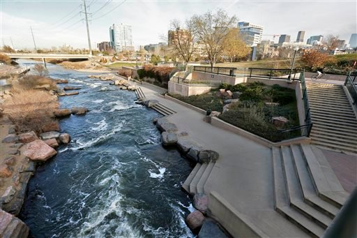 In this Monday, Dec. 8, 2014 photo, water flows past a sculpted landscape at Confluence Park, where Cherry Creek joins the South Platte, a key channel in Colorado's water supply, in Denver. (AP Photo/Brennan Linsley)