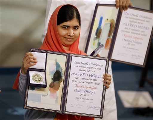 Nobel Peace Prize winners Malala Yousafzai from Pakistan, front, and Kailash Satyarthi of India are awarded their Nobel Peace Prize during the Nobel Peace Prize award ceremony in Oslo, Norway, Wednesday, Dec. 10, 2014. (AP)