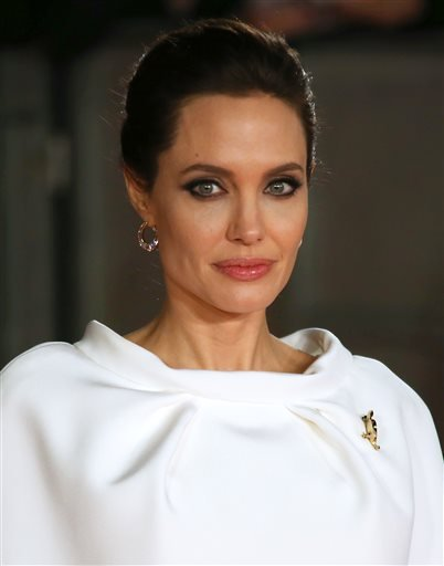 """In this Nov. 25, 2014 file photo, director Angelina Jolie poses for photographers upon arrival at the premiere of the film """"Unbroken"""" in London."""