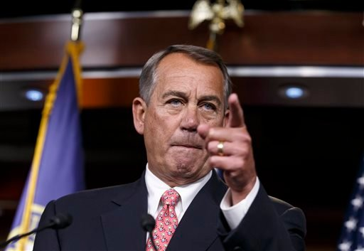 House Speaker John Boehner of Ohio holds what may be his last news conference of the 113th Congress, though critical legislation is still pending, Thursday, Dec. 11, 2014, on Capitol Hill in Washington. With a midnight Thursday deadline to keep the govern