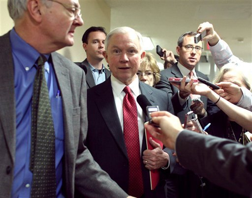 Sen. Jeff Sessions, R-Alabama talks to reporters on Capitol Hill in Washington, Friday, Dec. 12, 2014, as the Senate considers a spending bill. The House has passed an additional stopgap spending to make certain the government doesn't shut down at midnigh