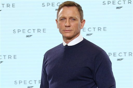 In this Thursday, Dec. 4, 2014, file photo actor Daniel Craig poses for photographers at the announcement for the new Bond film, the 24th in the series, at Pinewood Studios in west London. The title of the new Bond production is Spectre. The producers of