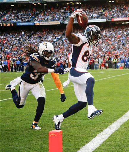 Denver Broncos wide receiver Demaryius Thomas, right, scores past San Diego Chargers defensive back Jahleel Addae during the second half of an NFL football game Sunday, Dec. 14, 2014, in San Diego.