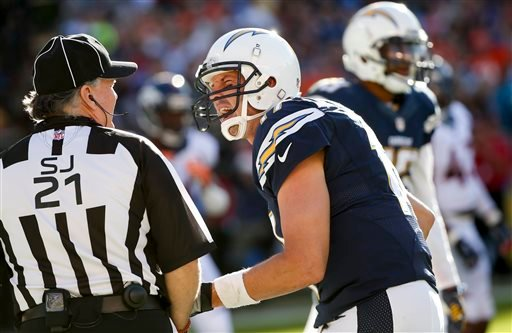 San Diego Chargers quarterback Philip Rivers complains to side judge Jeff Lamberth during the first half of an NFL football game against the Denver Broncos, Sunday, Dec. 14, 2014, in San Diego.