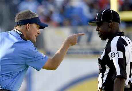 San Diego Chargers head coach Mike McCoy, left, has a word with umpire Roy Ellison during the first half of an NFL football game against the Denver Broncos, Sunday, Dec. 14, 2014, in San Diego.