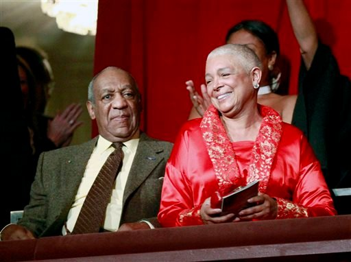 FILE - This Oct. 26, 2009 file photo, comedian Bill Cosby, left, and his wife Camille appear at the John F. Kennedy Center for Performing Arts before Bill Cosby received the Mark Twain Prize for American Humor in Washington. (AP)