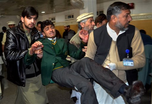 PESHAWAR, Pakistan (AP) — Taliban gunmen stormed a military-run school in the northwestern Pakistani city of Peshawar on Tuesday, killing at least 126 people before Pakistani officials declared a military operation to clear the school over.  The overwhel