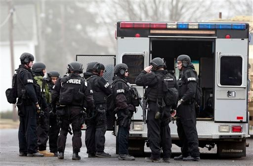 Police make preparations at a staging area for the search for suspect Bradley William Stone, Tuesday, Dec. 16, 2014, in Pennsburg, Pa. (AP Photo/Matt Rourke)