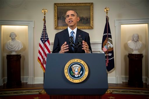 President Barack Obama speaks in the Cabinet Room of the White House in Washington, Wednesday, Dec. 17, 2014, to announce the U.S. will end its outdated approach to Cuba. (AP Photo/Doug Mills, Pool) COPYRIGHT 2014 THE ASSOCIATED PRESS.