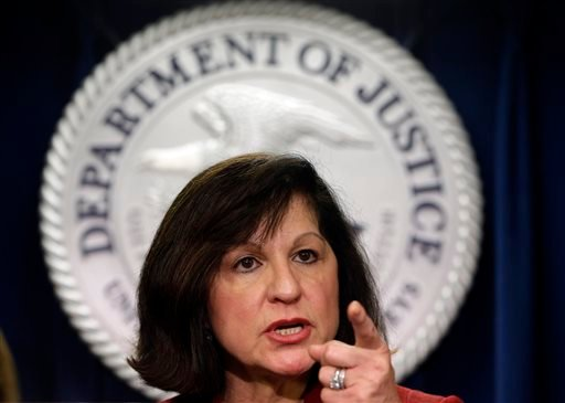 United States Attorney Carmen Ortiz announces indictments of 14 owners and employees from the New England Compounding Center Wednesday, Dec. 17, 2014, in Boston. (AP Photo/Steven Senne)