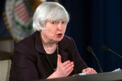 Federal Reserve Chair Janet Yellen speaks with reporters at the Federal Reserve in Washington, Wednesday, Dec. 17, 2014. (AP)