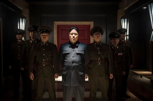 """In this undated photo provided by Columbia Pictures - Sony, Actor Randall Park, center, portrays North Korean leader Kim Jong Un in Columbia Pictures' """"The Interview."""" (AP Photo/Columbia Pictures - Sony, Ed Araquel)"""