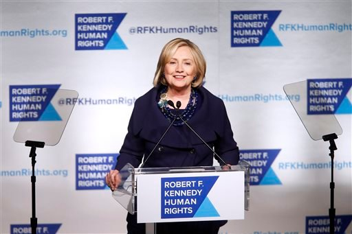 Dec. 16, 2014 file photo: Hillary Clinton speaks accepts the Robert F. Kennedy Ripple of Hope Award. Clinton didn't comment on President Obama's announcement on resuming relations with Cuba. (AP Photo/Jason DeCrow) COPYRIGHT 2014 THE ASSOCIATED PRESS.