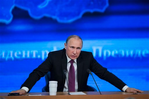 Russian President Vladimir Putin speaks during his annual news conference in Moscow, Russia, Thursday, Dec. 18, 2014. (AP)