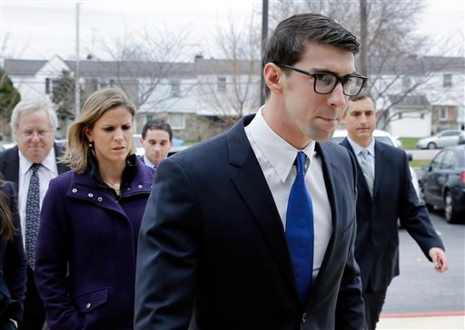 Olympic swimmer Michael Phelps walks into a courthouse for a trial on drunken driving and other charges, Friday, Dec. 19, 2014, in Baltimore. Documents show that the 29-year-old was leaving Baltimore's Horseshoe Casino Sept. 30 when he was pulled over for